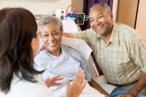 older woman consults with her doctor on HRT